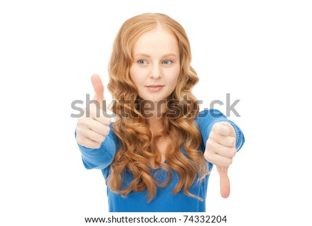 bright picture of lovely teenage girl with thumbs up and thumbs down