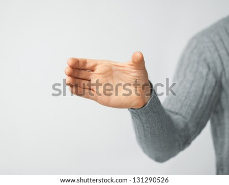 bright picture of man holding imaginary object - stock photo