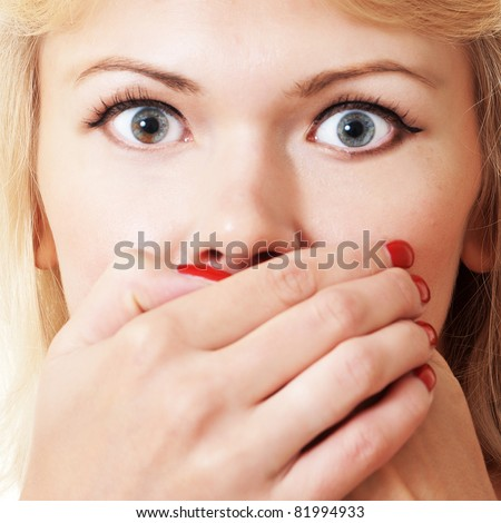 bright picture of pretty woman with hands over mouth - stock photo