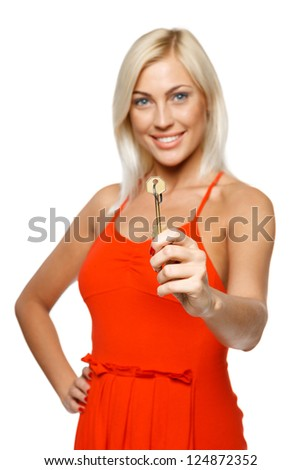 Bright picture of pretty young lady giving you a key, focus on the key, isolated on white background - stock photo