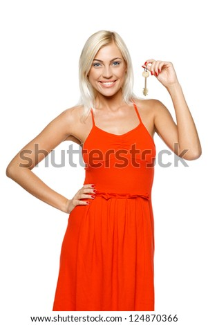 Bright picture of pretty young lady holding a key isolated on white background - stock photo