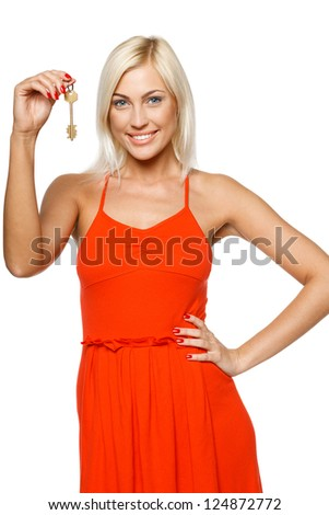 Bright picture of pretty young lady holding keys isolated on white background - stock photo