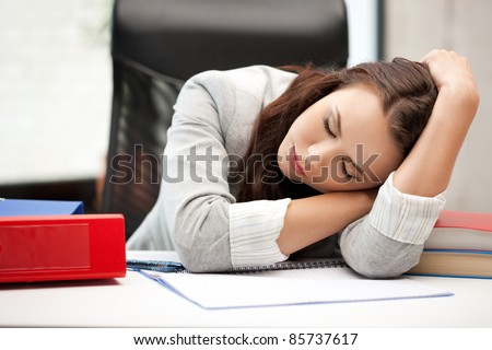 bright picture of sleeping woman with book