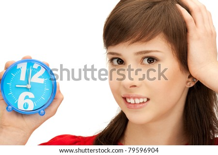 bright picture of teenage girl holding alarm clock - stock photo