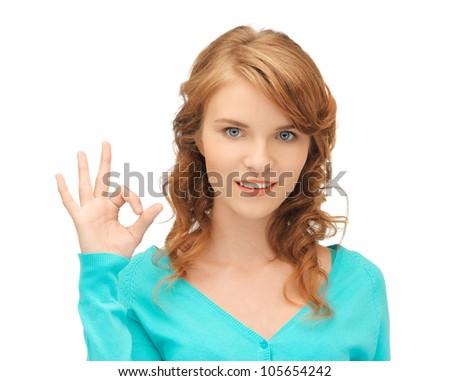bright picture of teenage girl showing ok sign