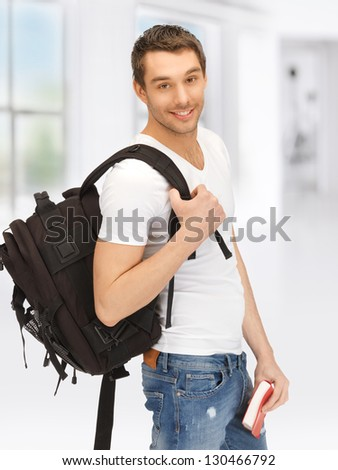 bright picture of travelling student with backpack and book