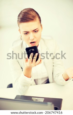bright picture of woman shouting into smartphone - stock photo
