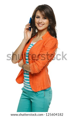 Bright picture of young woman talking on cellphone, over white background - stock photo
