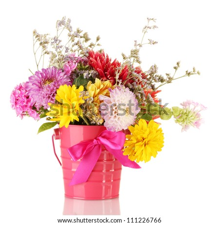Bright pink bucket with flowers isolated on white - stock photo