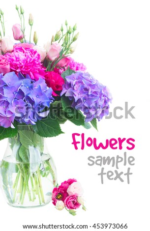 Bright pink peony, eustoma and blue hortensia flowers bouquet in vase close up isolated on white background - stock photo