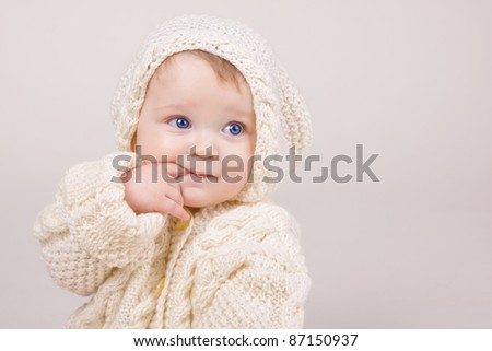 bright portrait of adorable baby in the sweater - stock photo