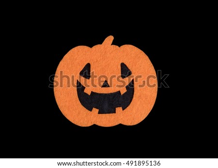 Bright pumpkin decoration isolated on black