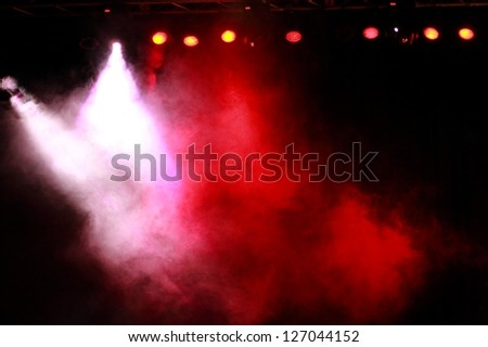 Bright red and violet theater concert lighting - stock photo