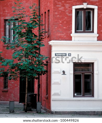 Bright red-and-white house in the city Oslo - Norway - stock photo