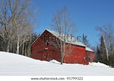 Bright red barn in the snow near Errol, New Hampshire