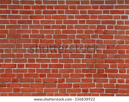 Bright red brick wall background, old solid brickwork surface - stock photo
