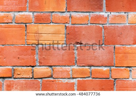 Bright red brick wall mansonry pattern, background photo texture
