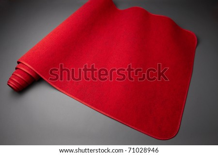 Bright red carpet unrolls for awards show includes space for copy - stock photo