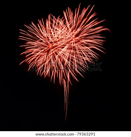 Bright red fireworks in the night sky in the form of heart - stock photo