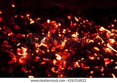 bright red hot charcoal fire screensaver close up
