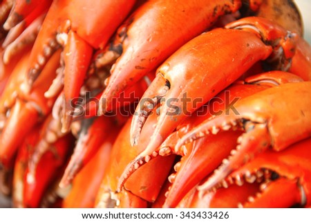 Bright red lobster claws in the market, Ready ingredients for cooking, Bangkok, Thailand. - stock photo