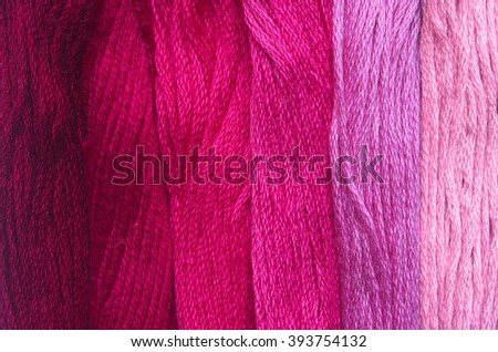 Bright red range of colors thread floss for embroidery and needlework. Sewing threads for embroidery close-up. Multicolor sewing threads texture. Mouline.  - stock photo