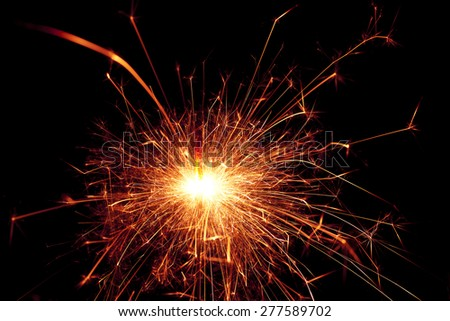Bright red sparks from a sparkler - stock photo