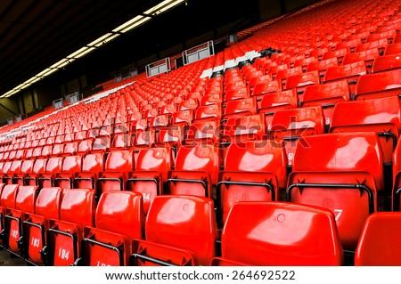 Bright red stadium seat - stock photo