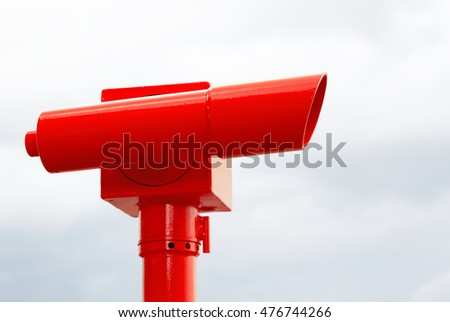 Bright red telescope used to view the ocean