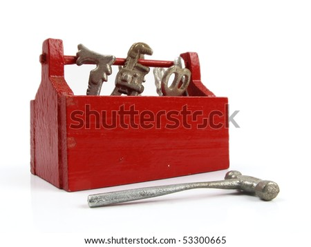 Bright red tool box full of little toy tools - stock photo