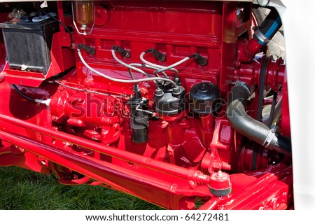Bright Red Vintage Tractor Engine Close Up Detail