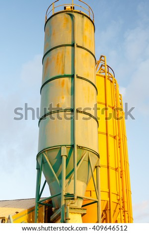 Bright round metal High rusted towers on chemical plant - stock photo