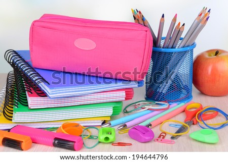 Bright school supplies on table on light background - stock photo