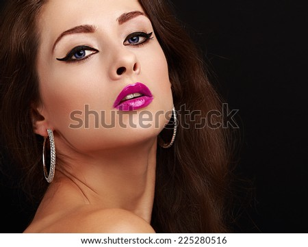 Bright sexy makeup with black arrows and bright pink lips. Closeup portrait