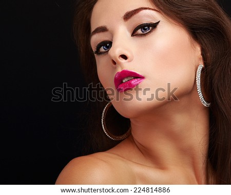 Bright sexy makeup with black arrows and pink lips. Closeup portrait
