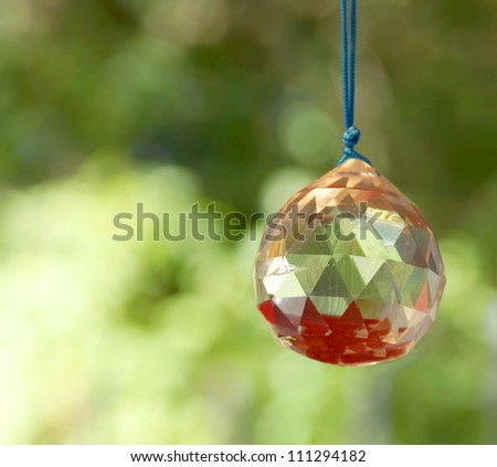 bright shiny crystal against a natural background - stock photo