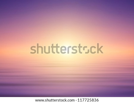 Bright sky and reflection in water surface during sunset. - stock photo