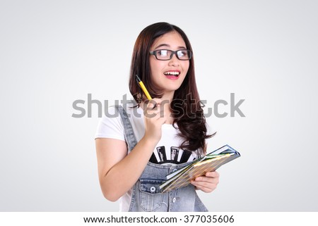 Bright smiling attractive Asian school girl gesturing idea / inspiration, on white background - stock photo