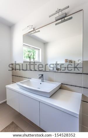 Bright space - a stone washbasin on a shelf - stock photo