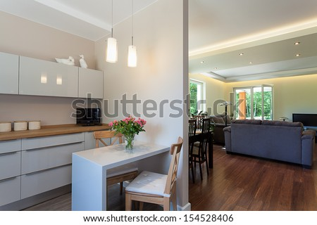 Bright space - a white kitchen and an elegant living room