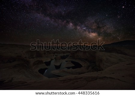 Bright Starry Night beautiful milky way over the Reflection Canyon Utah United States  - stock photo