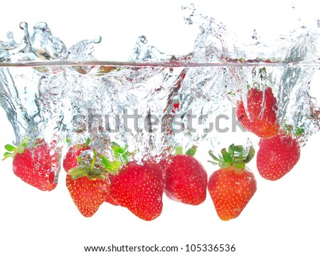 Bright strawberry and water splash. Tasty and healthy food - stock photo