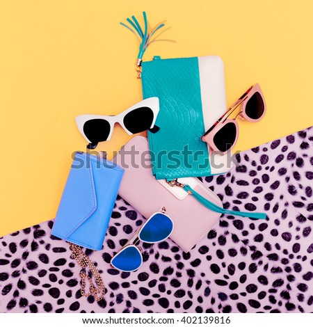 Bright Stylish Lady Accessories. Fashion Sunglasses and Clutch - stock photo