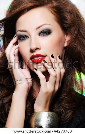 Bright stylish make-up on the beautiful pretty female face - stock photo