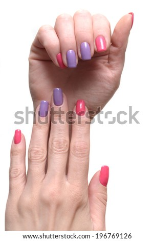 Bright stylish manicure with colored nail polish isolated. - stock photo