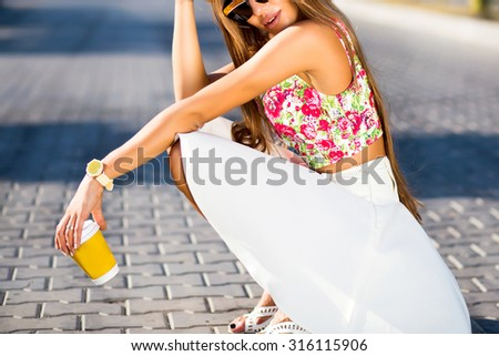 Bright summer fashion portrait of stylish hipster woman wearing vivid bright top,elegant jacket,mirrored sunglasses and swag hat,having fun on the street at sunny summer day,joy,vacation,travel  - stock photo