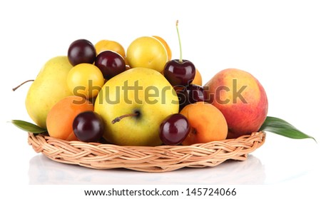 Bright summer fruits in basket isolated on white - stock photo