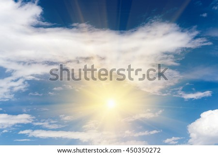 Bright sun in a blue sky with clouds - stock photo
