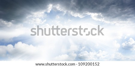 Bright sun in cloudy sky. Copy space - stock photo