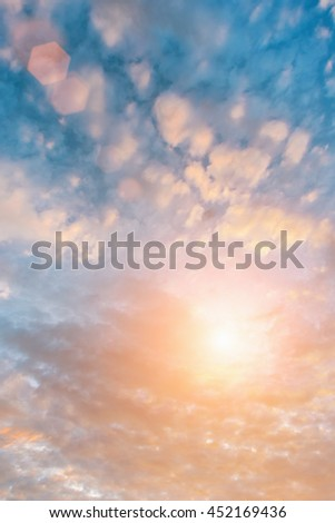 Bright sun in the blue sky with cirrus clouds - stock photo